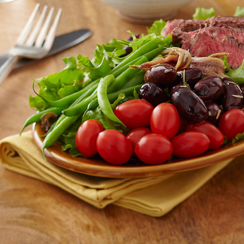 Grilled Steak and NatureSweet® Cherubs® Tomato Salad Nicoise