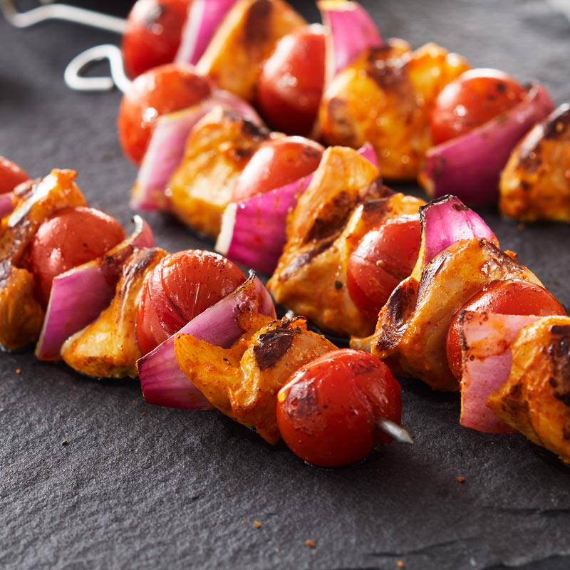 Spiced Chicken and NatureSweet® Glorys® Tomatoes Kebabs