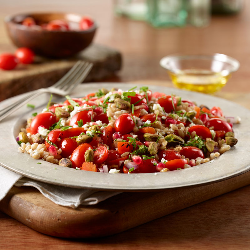 Farro Salad with NatureSweet® Cherubs® Tomatoes, Pistachios, and Pomegranate Seeds